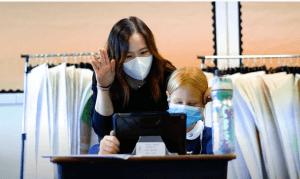 Teacher helping student hybrid